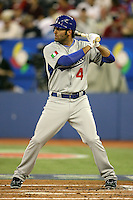 March 7, 2009:  Third baseman Mike Costanzo (4) of Italy during the first round of the World Baseball Classic at the Rogers Centre in Toronto, Ontario, Canada.  Venezuela defeated Italy 7-0 in both teams opening game of the tournament.  Photo by:  Mike Janes/Four Seam Images