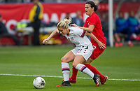 CARSON, CA - FEBRUARY 9: Abby Dahlkemper #7 of the United States defends against an advancing Christine Sinclair #12 of Canada during a game between Canada and USWNT at Dignity Health Sports Park on February 9, 2020 in Carson, California.