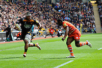 Nathan Hughes of Wasps looks to hand off Vereniki Goneva of Leicester Tigers
