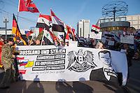 """250 bis 300 Menschen demonstrierten am Samstag den 31. Oktober 2015 in Berlin fuer die Unterstuetzung des syrischen Diktators Assad durch Russland. Sie trugen Fahnen Syriens, der ehemaligen Sowietunion, Russlands, Nordkoreas, der DDR, des Iran und Venezuelas, die sich """"alle zusammen gegen den Imperialismus zur Wehr setzen"""" wuerden. Russlands Praesident Putin wurde ausdruecklich fuer sein Militaerengagement gedankt, das Eingreifen der USA verurteilt.<br /> Im Bild 2.vl. am weissen Transparent mit Bart und blondem Seitenscheitel: Marc Kluge, laut Szeneinsidern ist er langjaehriger Neonaziaktivist. In Magdeburg, war er fuer den """"Selbstschutz Sachsen-Anhalt"""" aktiv und NPD-Kandidat.<br /> 31.10.2015, Berlin<br /> Copyright: Christian-Ditsch.de<br /> [Inhaltsveraendernde Manipulation des Fotos nur nach ausdruecklicher Genehmigung des Fotografen. Vereinbarungen ueber Abtretung von Persoenlichkeitsrechten/Model Release der abgebildeten Person/Personen liegen nicht vor. NO MODEL RELEASE! Nur fuer Redaktionelle Zwecke. Don't publish without copyright Christian-Ditsch.de, Veroeffentlichung nur mit Fotografennennung, sowie gegen Honorar, MwSt. und Beleg. Konto: I N G - D i B a, IBAN DE58500105175400192269, BIC INGDDEFFXXX, Kontakt: post@christian-ditsch.de<br /> Bei der Bearbeitung der Dateiinformationen darf die Urheberkennzeichnung in den EXIF- und  IPTC-Daten nicht entfernt werden, diese sind in digitalen Medien nach §95c UrhG rechtlich geschuetzt. Der Urhebervermerk wird gemaess §13 UrhG verlangt.]"""