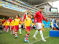 Steven Gerrard of England leads his team out