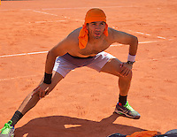 Austria, Kitzbuhel, Juli 15, 2015, Tennis, Davis Cup, Training Dutch team, Jean-Julien Rojer streching<br /> Photo: Tennisimages/Henk Koster