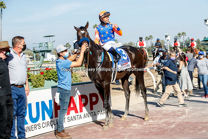 ARCADIA, CA  APRIL 3:  #3 Rock Your World Umberto Rispoli in the winners circle after winning the Santa Anita Derby (Grade l) on April 3, 2021 at Santa Anita Park, in Arcadia, CA.(Photo by Casey Pnillips/ Eclipse Sportswire/ CSM)