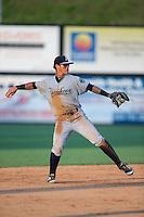 Pulaski Yankees shortstop Wilkerman Garcia (28) warms up between innings of the game against the Danville Braves at American Legion Post 325 Field on July 31, 2016 in Danville, Virginia.  The Yankees defeated the Braves 8-3.  (Brian Westerholt/Four Seam Images)