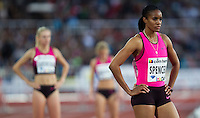22 AUG 2013 - STOCKHOLM, SWE - Kaliese Spencer (right) of Jamaica waits for the start of the women's 400m hurdles during the DN Galen meet of the 2013 Diamond League at the Stockholm Olympic Stadium in Stockholm, Sweden (PHOTO COPYRIGHT © 2013 NIGEL FARROW, ALL RIGHTS RESERVED)
