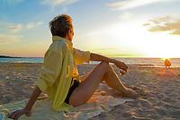 Woman relaxing near sunset at Maunakea Beach