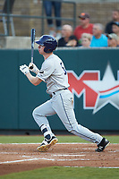 Grant Witherspoon (5) of the Princeton Rays follows through on his swing against the Pulaski Yankees at Calfee Park on July 14, 2018 in Pulaski, Virginia. The Rays defeated the Yankees 13-1.  (Brian Westerholt/Four Seam Images)