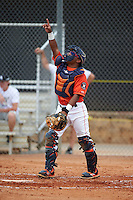GCL Astros catcher Ruben Castro (17) points to a popup during a game against the GCL Braves on July 23, 2015 at the Osceola County Stadium Complex in Kissimmee, Florida.  GCL Braves defeated GCL Astros 4-2.  (Mike Janes/Four Seam Images)
