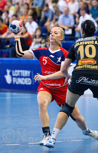 30 MAY 2012 - LONDON, GBR - Nina Heglund (GBR) of Great Britain (left, in red and blue) passes during the women's 2012 European Handball Championship qualification match against Montenegro at the National Sports Centre in Crystal Palace, Great Britain .(PHOTO (C) 2012 NIGEL FARROW)