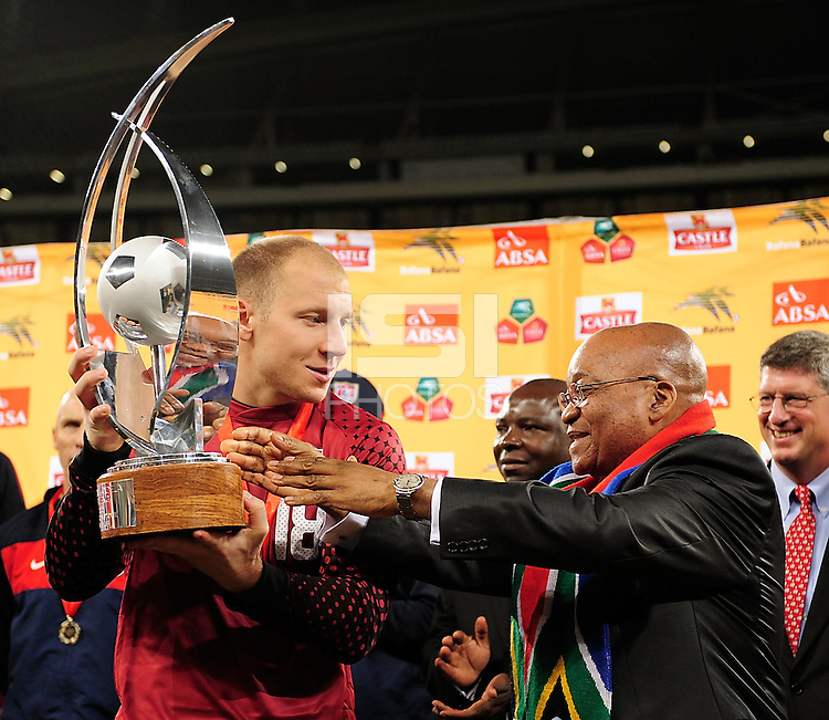 18 Brad Guzan of the USA receiving the Nelson Mandela trophy from Preident Jakob Zuma during the  Soccer match between South Africa and USA played at the Greenpoint in Cape Town South Africa on 17 November 2010.  Photo: Gerhard Steenkamp/ISI Photo