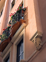 Flowers decorate balcony window of building on Via dell'Arco, Padua Ital