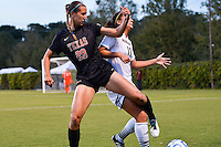 Texas forward Olivia Brook (29) and Texas State defender Kristen Champion (17) fight for ball possession during the first half of an NCAA soccer game, Sunday, September 21, 2014 in San Marcos, Tex. Texas defeated Texas State 2-0. (Mo Khursheed/TFV Media via AP Images)