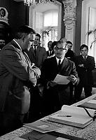 Le Premier Ministre de l'Ontario, John Roberts et le Premier Ministre du Quebec Jean-Jacques Bertrand lors de la signature de l'entente sur la cooperation interprovinciale, le 4 Juin 1969<br /> <br /> Photo : Photo Moderne - © Agence Quebec Presse