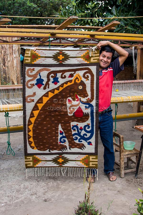 Santa Ana del Valle; Oaxaca; Mexico; North America.  Weaver Ernesto Martinez Cruz and Jaguar Carpet.