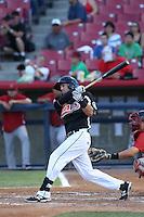 Tyler Smith #12 of the Visalia Rawhide bats against the High Desert Mavericks at Heritage Field on July 19, 2014 in Adelanto, California. Visalia defeated High Desert, 10-9. (Larry Goren/Four Seam Images)