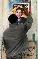 "Palestinain putting a martyr poster  after isreal withdrawal from gaza strip.March.03.2008.""phto by Fady Adwan"""