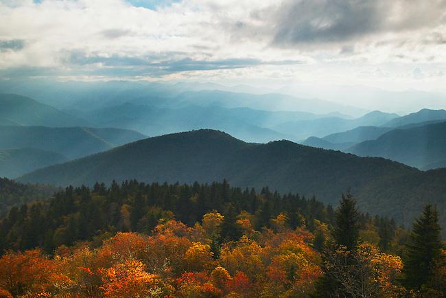 Sunbeams and autumn color at Cowee Mountains Overlook, Nantahala National Forest, Blue Ridge Parkway, North Carolina