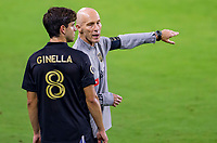 LOS ANGELES, CA - SEPTEMBER 13: LAFC head coach Bob Bradley teaching  Francisco Ginella #8 a few things during a game between Portland Timbers and Los Angeles FC at Banc of California stadium on September 13, 2020 in Los Angeles, California.