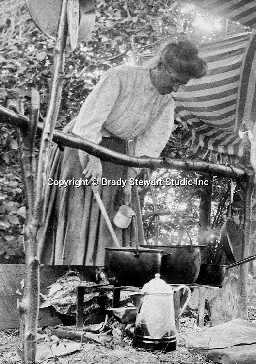 North East PA: Lake Erie Cookout, Alice Brady Stewart mixing food in the pots. During the early 1900s, the Stewart family vacationed on Lake Erie near North East Pennsylvania. Since hotels and motels were non-existent, camping was the only viable option for a large number of vacationers