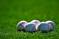 6 June 2009: A group of five new baseballs lie on the grass prior to a game between the New York Mets and the Washington Nationals at Nationals Park in Washington, DC. The Mets fell to the Nationals 7-1 as Nats' starting pitcher John Lannan tossed his first career complete-game win. Mandatory Credit: Ed Wolfstein Photo