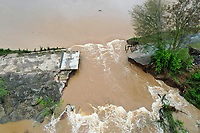 A section of the dam that creates Lake Bella Vista is seen washed away from Wednesday's storms. The break is in a section of the dam between to concrete overflow. The main dam gate and over flows became blocked by debris created during the storm. <br /> Check out nwaonline.com/210430Daily/ for today's photo gallery.<br />  (NWA Democrat-Gazette/Spencer Tirey)