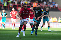 Nathan Baker of Bristol City vies for possession with Borja Baston of Swansea City during the Sky Bet Championship match between Bristol City and Swansea City at Ashton Gate in Bristol, England, UK. Saturday 21 September 2019