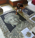 Pictured: Justin Bateman with his portrait of The Queen made from pebbles  <br /> <br /> A British artist stuck in Thailand has spent his time constructing masterpieces from pebbles for locals to enjoy.  Justin Bateman had only planned on staying in Chiang Mai for a week - but has remained there now for nearly ten months after the pandemic struck. <br /> <br /> His pebble portraits include The Queen, Spanish painter Pablo Picasso, Michelangelo's David and a local farmer - who was bemused by his portrait.   Mr Bateman, from Portsmouth, Hants, was staying in Bali when he travelled to Chiang Mai, in Thailand, to visit some friends.   SEE OUR COPY FOR DETAILS.<br /> <br /> Please byline: Justin Bateman/Solent News<br /> <br /> © Justin Bateman/Solent News & Photo Agency<br /> UK +44 (0) 2380 458800