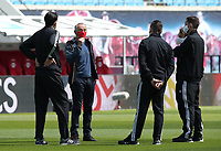 16th May 2020, Red Bull Arena, Leipzig, Germany; Bundesliga football, Leipzig versus FC Freiburg; trainer Christian Streich speaks to his team pre-game from a mask