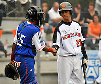 August 8, 2009:  New York Mets International Singing Bjorn Hato shakes hands with the catcher before an at bat while playing amateur baseball in Germany.  Hato, a Dutch native, signed with the Mets in 2009.  Photo By Gregor Eisenhuth/Four Seam Images