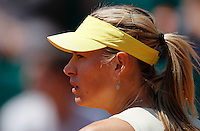 Maria Sharapova of Russialook at Andrea Petkovic of Germany in the quarter final match of the French Open tennis tournament in Roland Garros stadium in Paris, Wednesday June 1, 2011. Sharapova won in two sets 6-0, 6-3(foto: Srdjan Stevanovic/Starsportphoto ©)