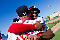 Oscar Taveras (25) of the Springfield Cardinals hugs hitting coach Phillip Wellman (30) of the Springfield Cardinals after winning a game against the Tulsa Drillers at Hammons Field on September 9, 2012 in Springfield, Missouri. (David Welker/Four Seam Images)