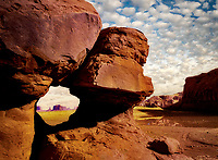 Pottery Arch framing rock structures. Monument Valley, Arizona