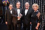 © Joel Goodman - 07973 332324 . 05/03/2015 .  Midland Hotel , Manchester , UK . L-R Eamonn O'Neill , winner LHS , sponsor ( MFL Professional ) and Louise Straw . Medium Law Firm of the Year . The Manchester Legal Awards 2015 . Photo credit : Joel Goodman