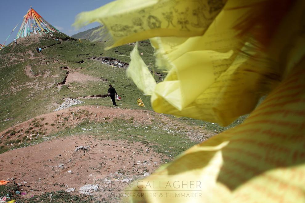 Tibetan prayer flags on top of a hill on the Qinghai-Tibetan Plateau, Qinghai Province. China. 2010