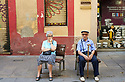 Men sitting on street  in  the City of Barcelona in Catalunya in Spain in Europe