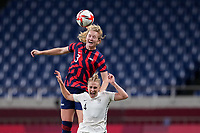 SAITAMA, JAPAN - JULY 24: Samantha Mewis #3 of the United States and CJ Bott #4 of New Zealand battle in the air for a ball during a game between New Zealand and USWNT at Saitama Stadium on July 24, 2021 in Saitama, Japan.