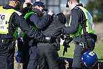 © Joel Goodman - 07973 332324 . 22/10/2016 . Margate , UK . An anti fascist protester is detained by police . A White Lives Matter protest and march , opposed by antifascists , is held in Margate , Kent . Photo credit : Joel Goodman