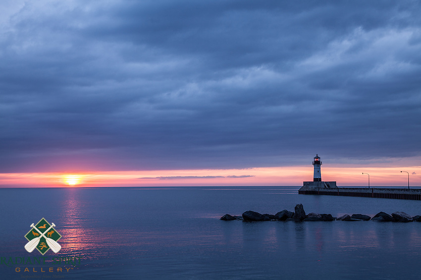 """""""Canal Park Sunrise""""<br /> The sun reached from beneath the incoming rain clouds to paint Lake Superior this morning. We admire Lake Superior in all her moods and glory."""