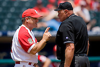 North Carolina State Wolfpack head coach Elliott Avent #9 argues a call with home plate umpire Tony Maners at the 2010 ACC Baseball Tournament at NewBridge Bank Park May 29, 2010, in Greensboro, North Carolina.  The Yellow Jackets defeated the Wolfpack 17-5.  Photo by Brian Westerholt / Four Seam Images