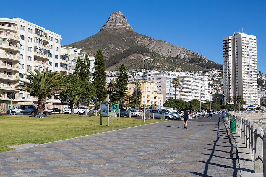 South Africa, Cape Town.  Sea Point Promenade.  Lion's Head in the Background.