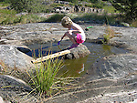 Young Girl Playing in Rock Pool in Kökar, Åland, Finland