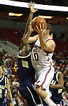Taylor Rochestie, Washington State University senior guard, drives to the basket during a game on December 13, 2008, at Key Arena in Seattle, Washington, against Montana State.  Rochestie and the Cougs defeated Montana State 70-51.