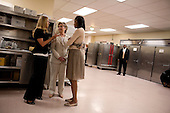 Denver, Colorado<br /> August 26, 2008<br /> <br /> Michelle Obama greets Senator Hillary Clinton backstage at the Sheraton Hotel in downtown Denver. Both addressed a Emily's List Gala reception in the hotel.