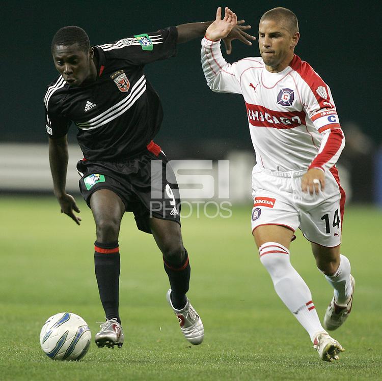 9 April 2005.  DC United's Freddy Adu (9) tries to take the ball past Chicago Fire midfielder Chris Armas (14)  at RFK Stadium in Washington, DC.