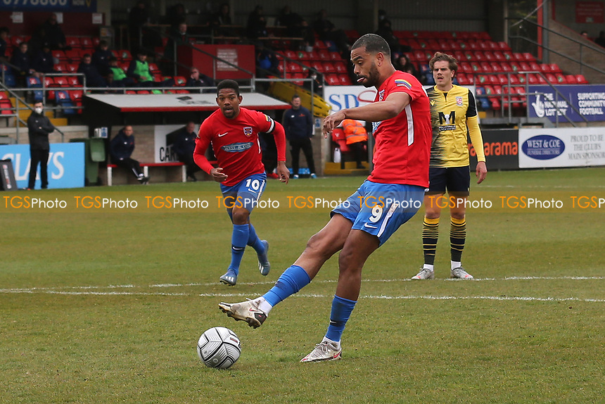 Paul McCallum of Dagenham and Redbridge scores the second goal for his team with a penalty during Dagenham & Redbridge vs Woking, Vanarama National League Football at the Chigwell Construction Stadium on 3rd May 2021