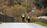Pictured: Police officers walk on the road by river Ogmore near Stormy Down, Wales, UK. Tuesday 22 November 2016<br />