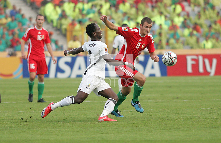 Hungary's Andras Simon (8) gets past Ghana's Emanuel Agyemang-Badu (8) during the FIFA Under 20 World Cup Semi-final match at the Cairo International Stadium in Cairo, Egypt, on October 13, 2009. Costa Rica won the match 1-2 in overtime play. Ghana won the match 3-2.