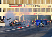 May 18, 2014; Commerce, GA, USA; NHRA top fuel driver Bob Vandergriff Jr (left) loses control and goes on two wheels alongside Clay Millican during the Southern Nationals at Atlanta Dragway. Mandatory Credit: Mark J. Rebilas-USA TODAY Sports