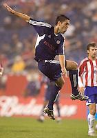 Clint Dempsey follows through on a shot. New England Revolution defeat CD Chivas USA, 1-0 at Gillette Stadium on April 30, 2005.