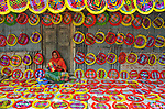 Women in a Bangladeshi village painstakingly hand make colourful fans.<br /> <br /> The brightly coloured pieces are made from bamboo, yarn and plastic sticks, and are sold during local festivals and summer months, with hundreds of them being made in the village of Sadullapur, Bangladesh.<br /> <br /> Please byline: Shafiul Islam/Solent News<br /> <br /> © Shafiul Islam/Solent News & Photo Agency<br /> UK +44 (0) 2380 458800